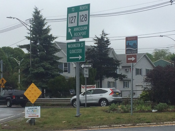 ANDREA HOLBROOK/Courtesy photo<br /> A sign labeling Washington Street as part of the Essex Coastal Scenic Byway directs drivers on the Grant Circle rotary toward Gloucester Harbor.