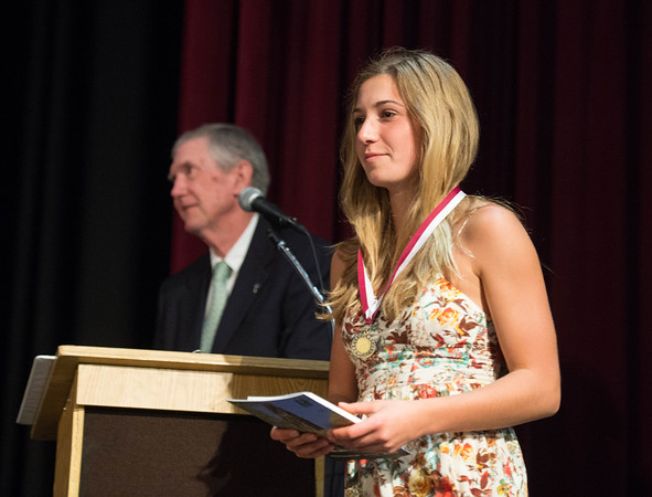 Desi Smith/Staff photo.  Carly Curcuru walks away from the podium after receiving the Yale Book Prize Thursday night during the Gloucester High School Academic Recognition Night at the School.    May 26,2016