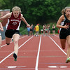 DAVID LE/Staff photo. Gloucester's Sierra Rudolph, left, edges out Marblehead's Gabriella Mark, right, while lunging for the finish line in the girls 100 meter dash. 5/24/16.