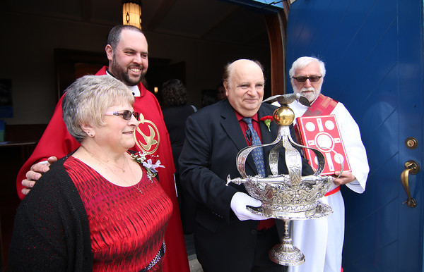 Gloucester: At the Annual Crowning Feast of the Holy Spirit held at Our Lady of Good Voyage Parish on Sun., May 15, 2016. Bart and Mary Piscitello were honored this year with the Crown and they and their family were crowned first at the end of the Mass.  With them are Father Jim Achadinha, back left, and Deacon Ray Wellbank during a short procession into the church. Photo by Allegra Boverman