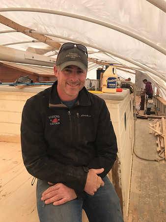 MARY MARKOS/Staff photo<br /> <br /> MARY MARKOS/Staff photo<br /> Capt. Tom Ryan talks about the work being done on the 1925 Essex-built Roseway at the Gloucester Marine Railways on Rocky Neck. The public is invited to tour the schooner Saturday from 8 to 11 a.m.