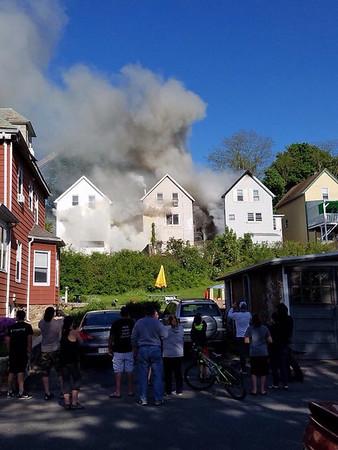STEVE AIELLO/Courtesy photo<br /> Neighbors watch the Centennial Avenue fire scene from a street over.