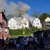 STEVE AIELLO/Courtesy photo<br /> Neighbors watch the Centennial Avenue fire scene from a street over.