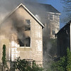 Vincenzo Dimino<br /> Smoke pours through one of the three homes that caught fire on Centennial Avenue on Saturday afternoon.