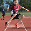 MIKE SPRINGER/Staff photo<br /> Sixth-grader Colby Rochford of Gloucester competes in the long jump in the Northeastern Conference middle school track meet Wednesday at Newell Stadium in Gloucester.<br /> 5/23/2018