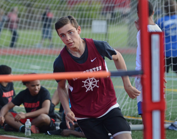 MIKE SPRINGER/Staff photo<br /> Seventh-grader Frank DeSisto of Gloucester competes in the high jump in the Northeastern Conference middle school track meet Wednesday at Newell Stadium in Gloucester.<br /> 5/23/2018
