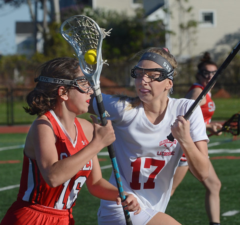 MIKE SPRINGER/Staff photo<br /> Salem's Serena Ross, left, carries the ball upfield as Liz Luster of Gloucester keeps apace during varsity lacrosse action Monday in Gloucester.<br /> 5/21/2018