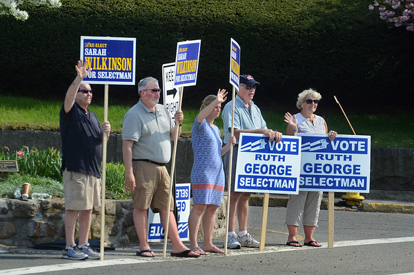 MIKE SPRINGER/Staff photo<br /> Rockport Board of Selectman incumbent Sarah Wilkinson and challenger Ruth George wave to motorists alongside supporters on election day Tuesday at the Five Corners intersection in Rockport. From left are John Grosse, Joe Chambers, Sarah Wilkinson, Buddy Woods and Ruth George.<br /> 5/15/2018