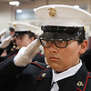 MIKE SPRINGER/Staff photo<br /> U.S. Marine JROTC cadet Jacquelyn Garcia, a freshman, salutes during a drill Tuesday at Gloucester High School.<br /> 5/15/2018