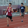 MIKE SPRINGER/Staff photo<br /> Eighth-grader Allan Segura of Gloucester approaches the finish line way ahead of a Peabody runner in the 200-meter dash during the Northeastern Conference middle school track meet Wednesday at Newell Stadium in Gloucester.<br /> 5/23/2018