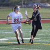 MIKE SPRINGER/Staff photo<br /> Gloucester's Maddie Vittands brings the ball upfield Tuesday during varsity lacrosse play against Malden at Gloucester.<br /> 5/8/2018