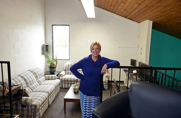 RYAN HUTTON/ Staff photo<br /> Nancy Marrs, Pass Program Director for the Greater Beverly YMCA, stands in the McPherson Youth Center's upstairs study room on Tuesday. [[MER1805221508373744]]