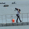 "MIKE SPRINGER/Staff photo<br /> A crew member carries a film camera up the ramp during a break from filming the German television movie ""Second Spring"" on Thursday at Conomo Point in Essex. ""Second Spring"" is the latest in a series of German TV films inspired by the work of British romance novelist Katie Fforde.<br /> 5/31/2018"