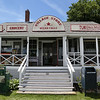"MIKE SPRINGER/Staff photo<br /> A waterfront cabin at Conomo Point in Essex is dressed up as a combined  general store, police office and handyman service on Thursday during the filming of a German television film, ""Second Spring.""<br /> 5/31/2018"