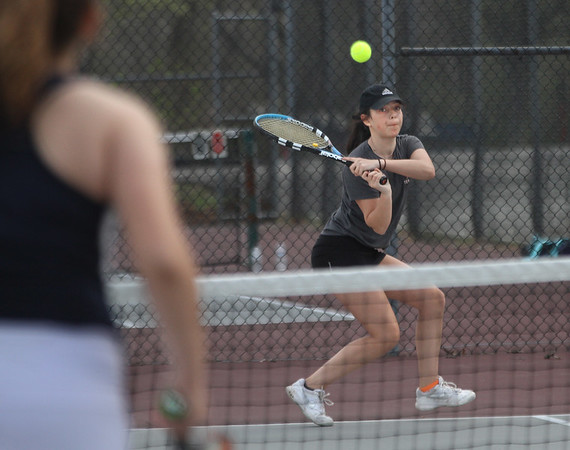 MIKE SPRINGER/Staff photo<br /> Rockport's Alexa Kamm competes against a Lynnfield player during varsity tennis Thursday in Rockport.<br /> 5/3/2018