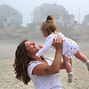 MIKE SPRINGER/Staff photo<br /> Jessica Toomey of Gloucester enjoys a moment Wednesday with her 10-month-old daughter Charlotte on a misty Long Beach in Gloucester. This Sunday, May 13, is Mother's Day.<br /> 5/9/2018