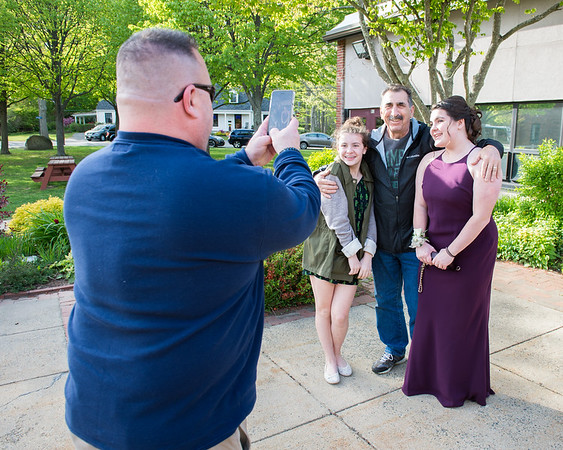 Desi Smith Photo.       Michael Scola of Gloucester, takes a photo of his two daughters, Ashlee Scola (left) Cali Scola (right) along with brother Ambie Scola, before heading into Rockport High School for the pre-prom promendade Friday night.   May 18,2018