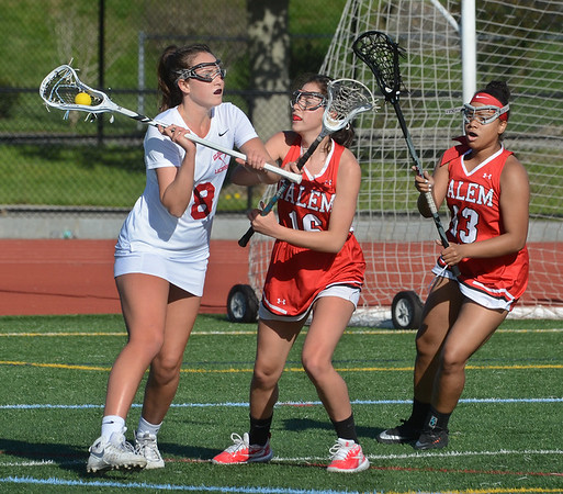 MIKE SPRINGER/Staff photo<br /> Gloucester's Sophie Caldwell, left, prepares to pass the ball during varsity lacrosse action Monday against Salem in Gloucester.<br /> 5/21/2018