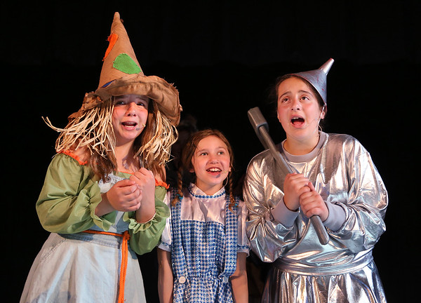 "MIKE SPRINGER/Staff photo<br /> Cast members of the Wizard of Oz -- from left, Ella Tucker as the Scarecrow, Nicole Pierce as Dorothy and Serina Russo as the Tin Man -- rehearse a scene Monday in this year's fifth grade play, ""The Wizard of Oz,"" at Beeman Memorial School in Gloucester. The musical, which features a cast of 28 students, will be presented this Thursday and Friday at 7 p.m. in the Beeman auditorium. Admission is $5 at the door.<br /> 5/14/2018"