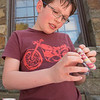 AMANDA SABGA/Staff photo<br /> <br /> Adrian Kuehnemund, 11, makes a bracelet as a Mother's Day gift at the Manchester Public Library. <br /> <br /> 5/2/18