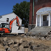 MIKE SPRINGER/Staff photo<br /> A worker uses a back hoe to clear stones Wednesday on the Acacia Street side of the old Maplewood School in Gloucester.<br /> 5/23/2018