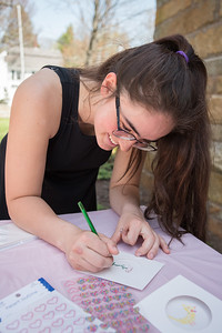 AMANDA SABGA/Staff photo  Bella Pomeroy, 17, designs a card and Mother's Day gifts at the Manchester Public Library.   5/2/18