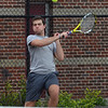 MIKE SPRINGER/Staff photo<br /> Chris Noyes, Gloucester's number one-ranked singles player, competes Wednesday against a Peabody player in Gloucester.<br /> 5/16/2018