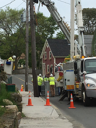 ANDREA HOLBROOK/Staff photo/National Grid crews get ready to switch out a transformer on a pole on Centennial Avenue near the Curtis Square intersection on Thursday around 1 p.m.