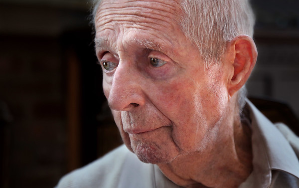 MIKE SPRINGER/Staff photo<br /> Robert McKinnon, 93, thinks back on his experience in the West Loch Disaster when he was a U.S. Navy sailor in 1944.<br /> 5/23/2018