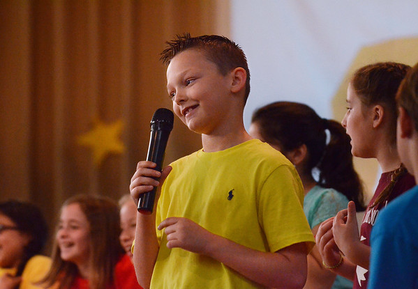 "MIKE SPRINGER/Staff photo<br /> Fifth-grader Zachary Lacey performs a scene Friday in ""School House Rock Jr."" at Veterans Memorial Elementary School.<br /> 5/25/2018"