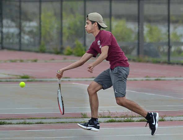 MIKE SPRINGER/Staff photo<br /> Roger Tanaka, Gloucester's number two-ranked singles player, competes Wednesday against a Peabody player in Gloucester.<br /> 5/16/2018