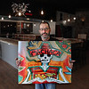 MIKE SPRINGER/Staff photo<br /> Luis Pardo, general manager of the soon-to-open Machaca taco and tequila bar in the former Katrina's location on Rogers Street in Gloucester, holds the bar's sign.<br /> 5/1/2018