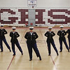 MIKE SPRINGER/Staff photo<br /> Members of the award-winning Gloucester High School U.S. Marines JROTC perform a drill Tuesday in the field house. From left are: freshman Laura Ryan, freshman Makayla Cruz, freshman Samantha Harvey, senior Aurora Billante, senior Exhibition Commander Crisbel Mercado, senior Yanna Peña-Ortiz, senior Lizbeth Peña-Ortiz, senior Samantha Gross and freshman Jacquelyn Garcia.<br /> 5/15/2018