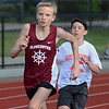 MIKE SPRINGER/Staff photo<br /> Seventh-grader Max Littman of Gloucester runs ahead of a Beverly athlete in the 800-meter run Wednesday in the Northeastern Conference middle school track meet at Newell Stadium in Gloucester.<br /> 5/23/2018