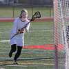 MIKE SPRINGER/Staff photo<br /> Gloucester's Caroline Muniz prepares to take a shot against Malden during varsity lacrosse play Tuesday in Gloucester.<br /> 5/8/2018