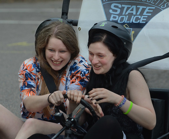 MIKE SPRINGER/Staff photo<br /> Brittany Nielsen, left, and Hanna Grover, both seniors laugh while trying to control a go cart that simulates the delayed reaction time of chemically-impaired driving on Tuesday during the annual Impaired Driving Awareness Day at Gloucester High School.<br /> 5/22/2018