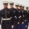 MIKE SPRINGER/Staff photo<br /> U.S. Marines JROTC cadets -- from left, junior Robert Buckley, sophomore Matthew Johnson, junior Jack Ho, freshman Alex Santa and senior Yanna Peña-Ortiz -- perform a drill Tuesday in the field house at Gloucester High School.<br /> 5/15/2018