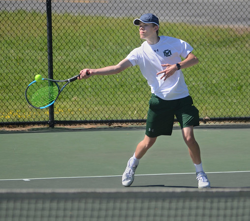 MIKE SPRINGER/Staff photo<br /> Anton Kozyrev, the number three-ranked singles player for Manchester Essex, hits a forehand Thursday against a Masconomet opponent in Manchester.<br /> 5/31/2018
