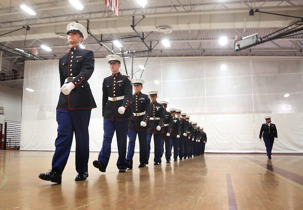 MIKE SPRINGER/Staff photo<br /> Exhibition Commander Crisbel Mercado, right, a senior, leads freshman Andrew Vozella, front, and other JROTC cadets in a drill Tuesday at Gloucester High School.<br /> 5/15/2018