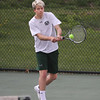 MIKE SPRINGER/Staff photo<br /> Garrett Lamothe of Manchester Essex competes in a singles match with a Swampscott player during varsity tennis Thursday in Manchester.<br /> 5/10/2018