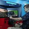 "MIKE SPRINGER/Staff photo<br /> Liam Wilber, a senior, drives a ""Distractology"" simulator while using his smart phone Tuesday at Gloucester High School. The simulator, sponsored by the Arbella Insurance Foundation, is designed to teach students about the effects on one's driving ability from various distractions, like listening to music or sending text messages. The ""Distractology"" simulator is visting the school for five days, and the visit was timed to coincide with Tuesday's annual Impaired Driving Awareness Day.<br /> 5/22/2018"