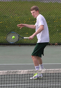 MIKE SPRINGER/Staff photo Brett Donovan of Manchester Essex competes in a doubles match Thursday against Swampscott during varsity tennis in Manchester. 5/10/2018