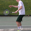 MIKE SPRINGER/Staff photo<br /> Brett Donovan of Manchester Essex competes in a doubles match Thursday against Swampscott during varsity tennis in Manchester.<br /> 5/10/2018