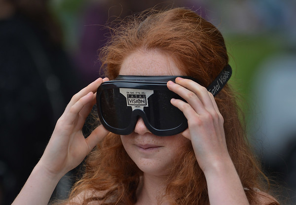 MIKE SPRINGER/Staff photo<br /> Christinea Jones, a senior, tries on a pair of goggles designed to simulate the effect of intoxication Tuesday during the annual Impaired Driving Awareness Day at Gloucester High School.<br /> 5/22/2018