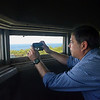 MIKE SPRINGER/Staff photo<br /> State Senator Bruce Tarr takes a photo from the observation tower Friday at Halibut Point State Park.<br /> 5/25/2018