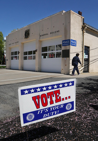 MIKE SPRINGER/Staff photo<br /> A woman enters the Essex Fire Station on Monday to cast her vote in the town election.<br /> 5/14/2018