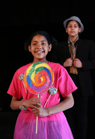 "MIKE SPRINGER/Staff photo<br /> Sasha Angeles-Tejada plays a member of the Lollipop Guild and Lana Beauregard, right, plays the Coroner in the Munchkin scene during a rehearsal Monday for ""The Wizard of Oz,"" this year's fifth grade play at Beeman School. The musical, which features a cast of 28 students, will be presented this Thursday and Friday at 7 p.m. in the Beeman auditorium. Admission is $5 at the door.<br /> 5/14/2018"