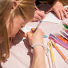 AMANDA SABGA/Staff photo<br /> <br /> Abby Lantz, 17, designs a card and Mother's Day gifts at the Manchester Public Library. <br /> <br /> 5/2/18