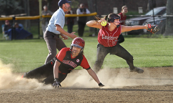 MIKE SPRINGER/Staff photo<br /> Gloucester shortstop Ella Marshall prepares to throw to first base for a double play after forcing out Marblehead's Sophia Vener during varsity softball play Friday in Gloucester.<br /> 5/11/2018