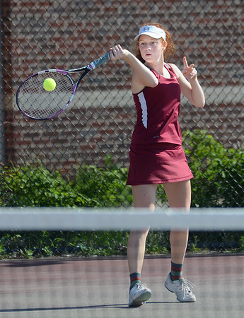 MIKE SPRINGER/Staff photo<br /> Christina Jones, Gloucester's number one singles player, hits a forehand during varsity tennis play Tuesday against Beverly in Gloucester.<br /> 5/29/2018